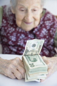 Elderly Lady with Money - purchased on iStock mgdonohue