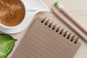 Blank Notepad & Cup of Coffee - iStock