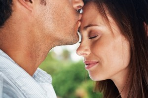 Man Kissing Womans Forehead - iStock