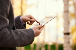 Man Looking At Tablet - iStock