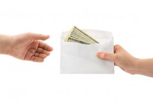 Hands and money in envelope - iStock